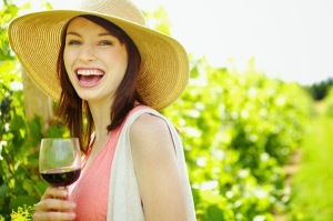 happy-woman-drinking-wine-summer