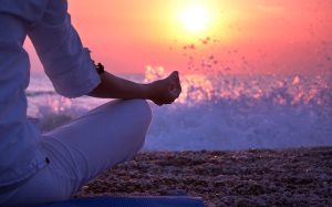 Woman Practicing Yoga near the Ocean at Sunset; Shutterstock ID 109839821; PO: aol; Job: production; Client: drone